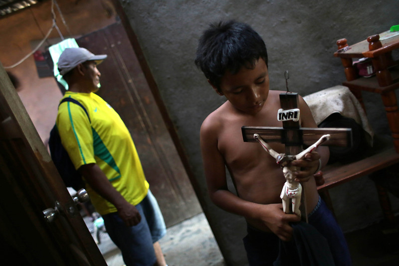 . A child picks up a crucifix at his home, damaged by an earthquake on the eve, in Nagarote, some 40 Km from Managua, on April 11, 2014. A 6.2-magnitude earthquake that struck Nicaragua killed one person, left 33 injured and damaged more than 800 homes, the government said Friday. (Inti Ocon/AFP/Getty Images)