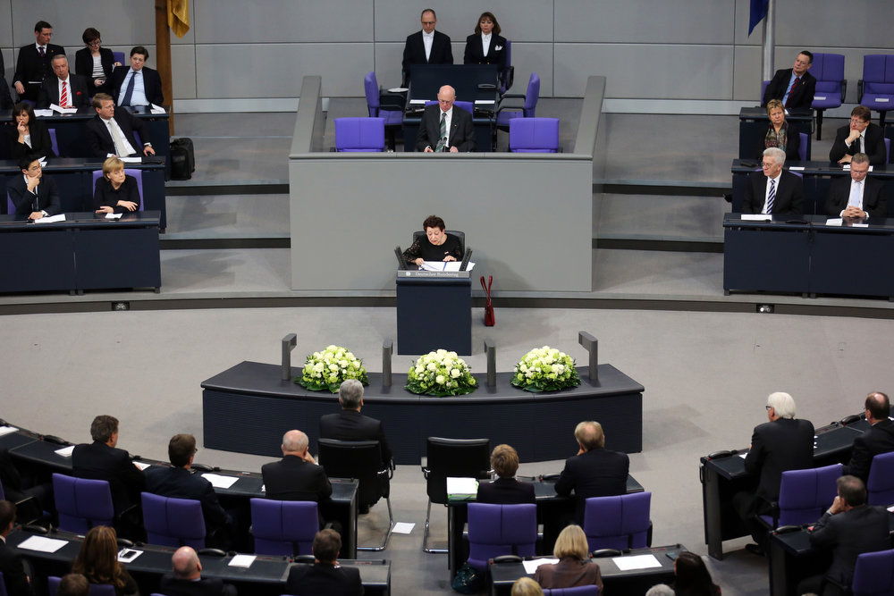 Description of . Holocaust survivor Inge Deutschkron delivers a speech during a commemorative event for the victims of the Nazi era at the German Bundestag parliament in Berlin, Germany, Jan. 30, 2013. Deutschkron, a 90-year-old Jewish Berliner and writer, recalled Germans celebrating Hitler's rise to power as she addressed lawmakers. She remembered her family growing more tense over the subsequent weeks amid worries about Hitler's paramilitary SA thugs who roamed the streets. (AP Photo/dpa, Kay Nietfeld)