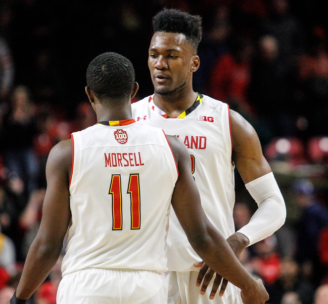 January 20, 2018: Maryland teammates Bruno Fernando (23) and Darryl Morsell (11) embrace after securing the game winning rebound during BIG Ten Men Basketball action between University of Wisconsin and University of Maryland in College Park. Photo by: Chris Thompkins/Prince Georges Sentinel