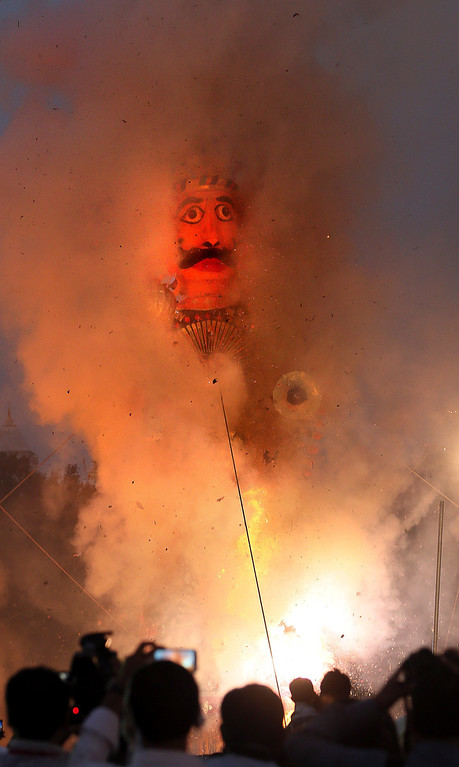 . An effigy of the ten-headed demon king Ravana burns during Dussehra celebrations in New Delhi, India, Sunday, Oct. 13, 2013. Dussehra festival commemorates the victory of Hindu god Rama over Ravana. The burning of effigies of Ravana, signifying the victory of good over evil, brings the festivities to a close. (AP Photo /Manish Swarup)