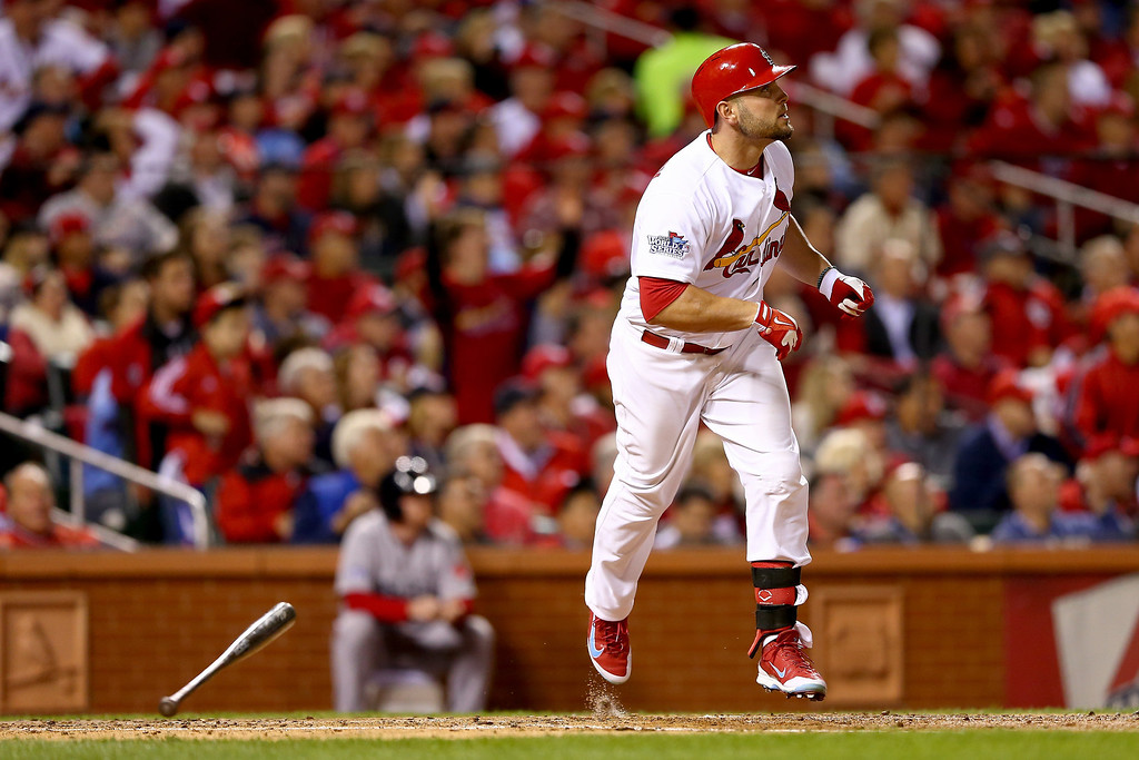 . Matt Holliday #7 of the St. Louis Cardinals hits a solo home run in the fourth inning against the Boston Red Sox during Game Five of the 2013 World Series at Busch Stadium on October 28, 2013 in St Louis, Missouri.  (Photo by Elsa/Getty Images)