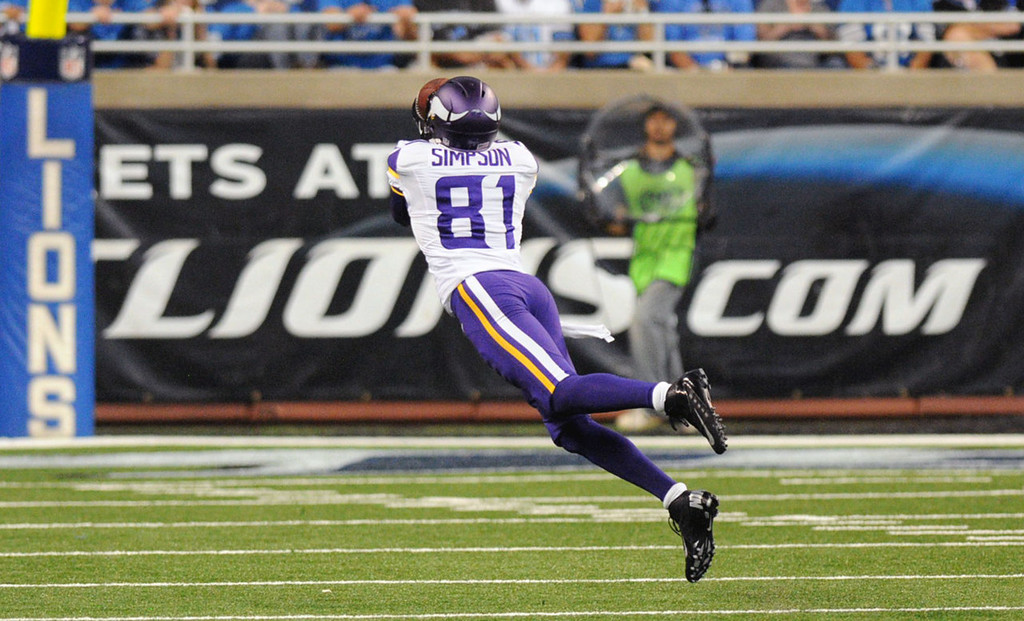 . Vikings wide receiver Jerome Simpson (81) catches a pass for a 47-yard gain in the third quarter against the Lions.  (Pioneer Press: Chris Polydoroff)