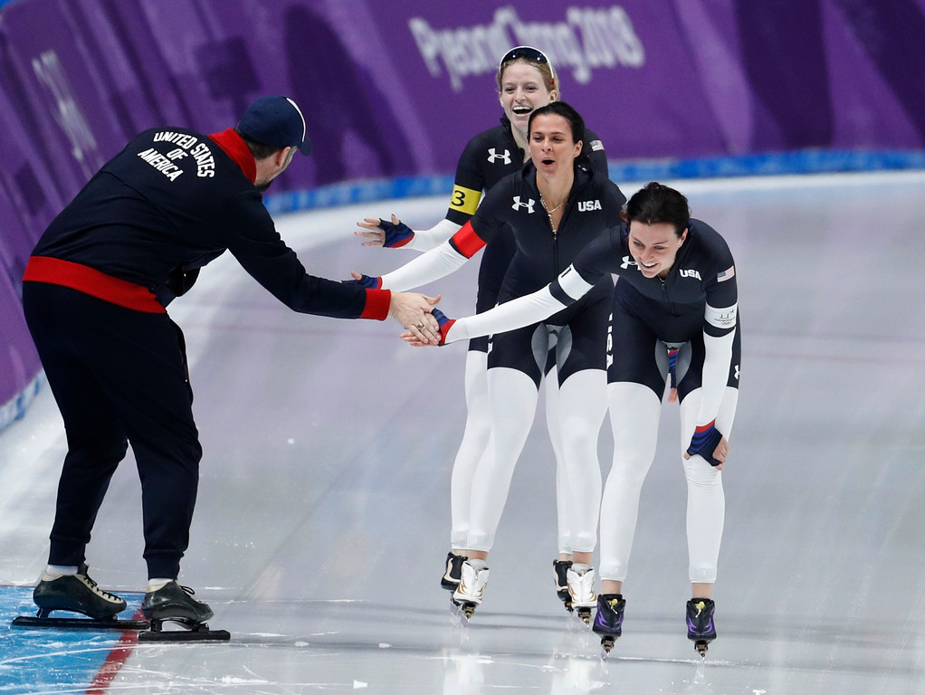 . Team U.S.A. with Heather Bergsma, front, Brittany Bowe, center, and Mia Manganello, rear, celebrates with their coach after the quarterfinals of the women\'s team pursuit speedskating race at the Gangneung Oval at the 2018 Winter Olympics in Gangneung, South Korea, Monday, Feb. 19, 2018. (AP Photo/John Locher)