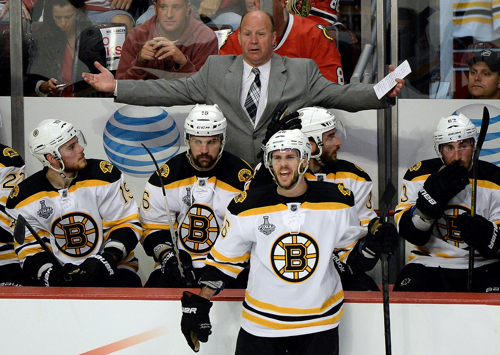 . Head coach Claude Julien of the Boston Bruins reacts to a penalty called for too many men on the ice in the second period against the Chicago Blackhawks in Game One of the 2013 NHL Stanley Cup Final at United Center on June 12, 2013 in Chicago, Illinois.  (Photo by Harry How/Getty Images)