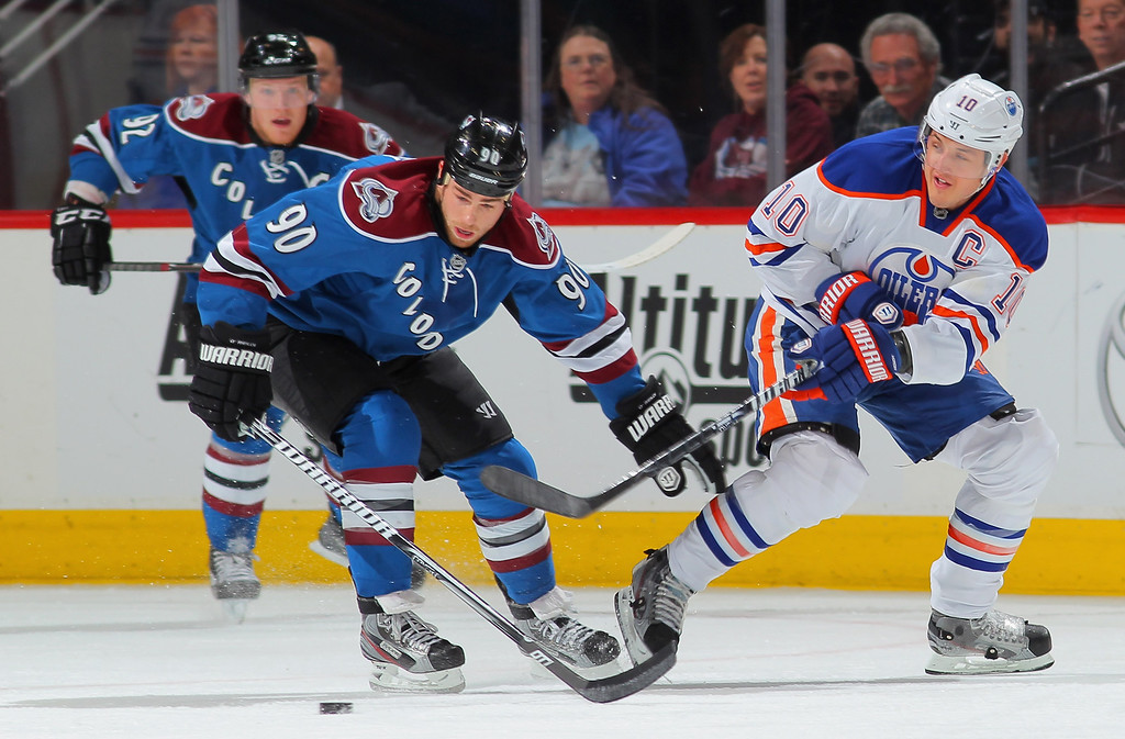 . DENVER, CO - APRIL 19:  Shawn Horcoff #10 of the Edmonton Oilers passes the puck away from Ryan O\'Reilly #90 of the Colorado Avalanche at the Pepsi Center on April 19, 2013 in Denver, Colorado.  (Photo by Doug Pensinger/Getty Images)