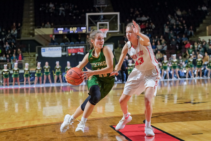 Oxford Hills' Brooke Carson drives against South Portland's Kaleisha Towle.