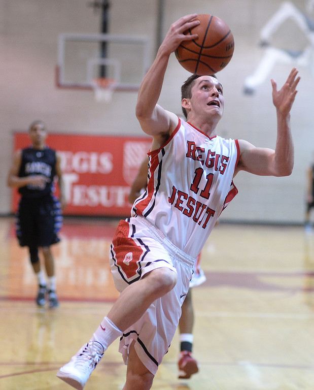 . Raiders\' senior guard Zach Smith (11) made a layup in the fourth quarter. The Regis Jesuit High School boy\'s basketball team defeated Highlands Ranch 63-54 Tuesday night, February 4, 2014. Photo By Karl Gehring/The Denver Post