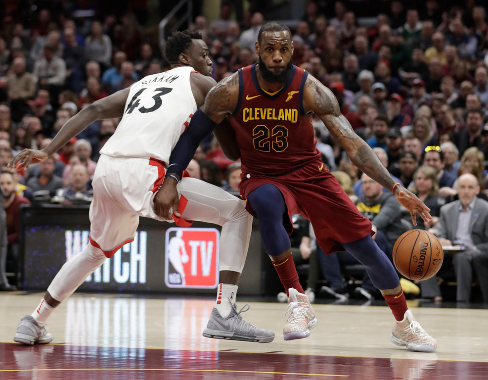 . Cleveland Cavaliers\' LeBron James (23) drives abasing Toronto Raptors\' Pascal Siakam (43), from Cameroon, in the second half of an NBA basketball game, Wednesday, March 21, 2018, in Cleveland. (AP Photo/Tony Dejak)