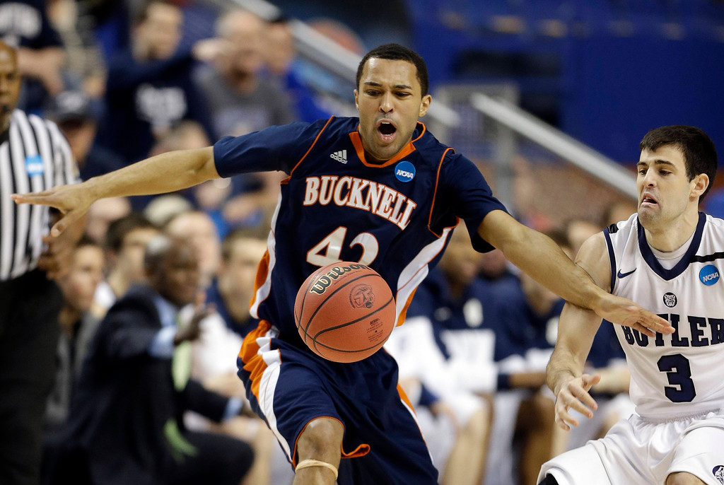 . Bucknell guard Cameron Ayers (42) has the ball knocked away by Butler guard Alex Barlow (3) during the first half their second round NCAA college basketball tournament game Thursday, March 21, 2013, in Lexington, Ky.  (AP Photo/John Bazemore)
