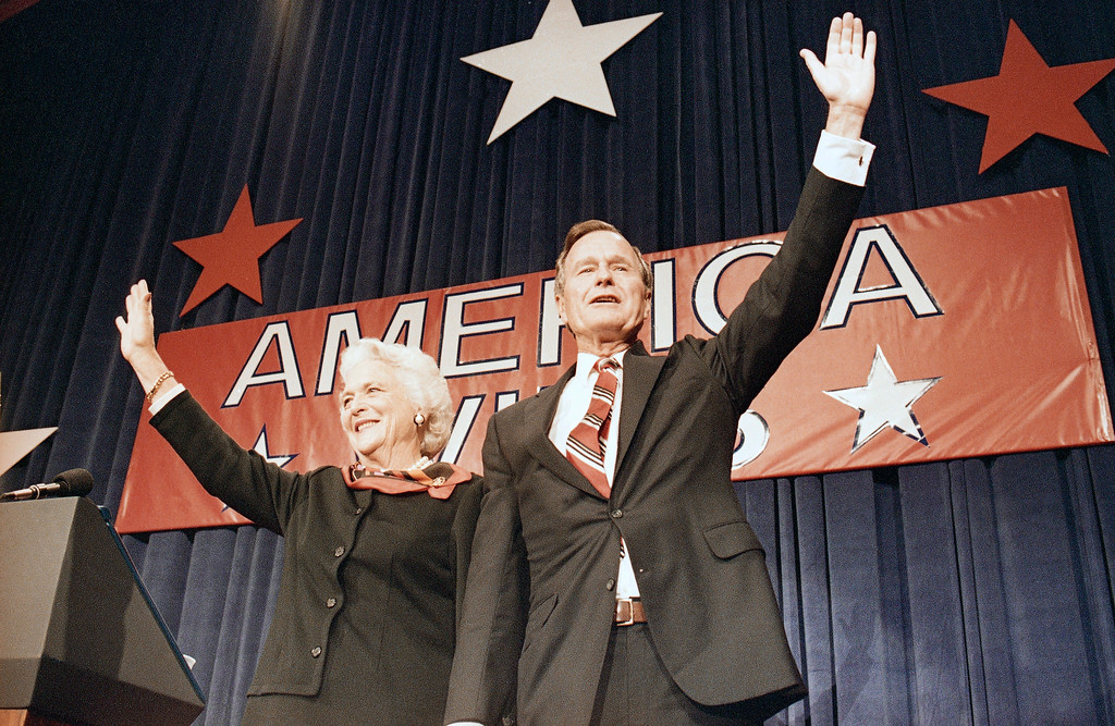 . President-elect George H.W. Bush, right, and his wife Barbara Bush, wave to the crowd at a victory celebration rally, Tuesday, Nov. 8, 1988, Houston, Tex. (AP Photo/J. Scott Applewhite)
