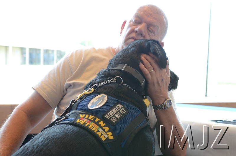 An unnamed Vietnam veteran is seen hugging his service dog during the Rally Point Job Fair and Ceremony at the KY Center for the Arts. June 23, 2016.