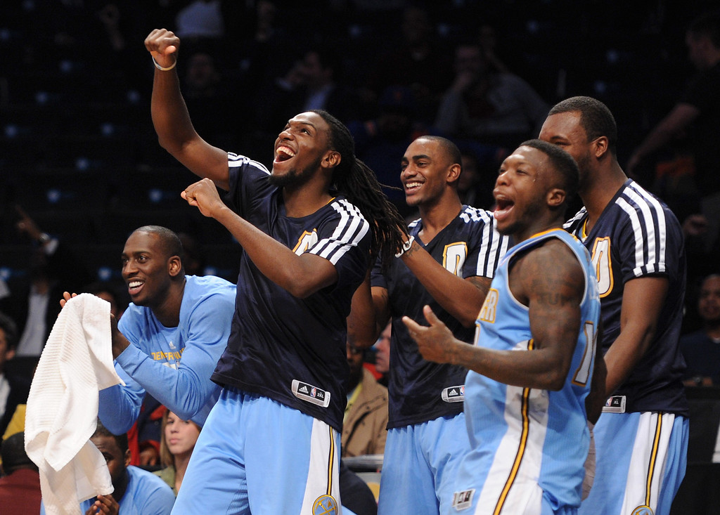 . NEW YORK, NY - DECEMBER 03:  Kenneth Faried #35 of the Denver Nuggets, second from left, and Nate Robinson #10, second from right, celebrate with teammates during the fourth quarter against the Brooklyn Nets at Barclays Center on December 3, 2013 in the Brooklyn borough of New York City. (Photo by Maddie Meyer/Getty Images)