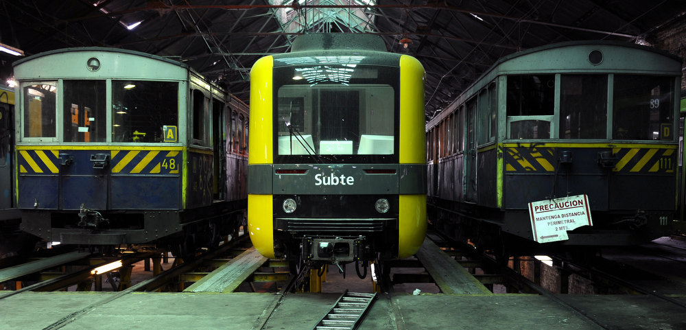 . Two historic wagons of La Brugeoise and one of the new Chinese train (C) remain parked at the garage El Polvorin, in the neighborhood of Caballito, Buenos Aires on January 4, 2013. The Line A will be closed betwen January 12 and March 8 following a decision by Buenos Aires city Mayor Mauricio Macri to replace the fleet with Chinese-made wagons. Line A was the first subway line to work in the southern hemisphere and its trains are among the ten oldest still working daily. The La Brugeoise wagons were constructed between 1912 and 1919 by La Brugeoise et Nicaise et Delcuve in Belgium. ALEJANDRO PAGNI/AFP/Getty Images