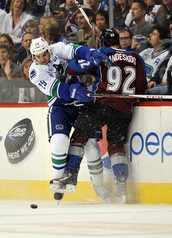 . DENVER, CO. - APRIL 13 : Gabriel Landeskog of Colorado Avalanche (92) checks Tom Sestito (29) of Vancouver Canucks in the 1st period of the game at Pepsi Center. Denver, Colorado. April 13, 2013. Colorado won 4-3. (Photo By Hyoung Chang/The Denver Post)