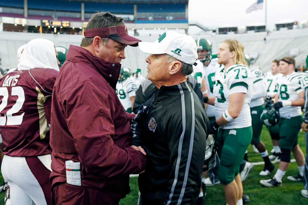 Description of . Louisiana-Monroe coach Todd Berry, left, congratulates Ohio coach Frank Solich after their 45-14 win in the Independence Bowl NCAA college football game in Shreveport, La., Friday, Dec. 28, 2012. (AP Photo/Rogelio V. Solis)