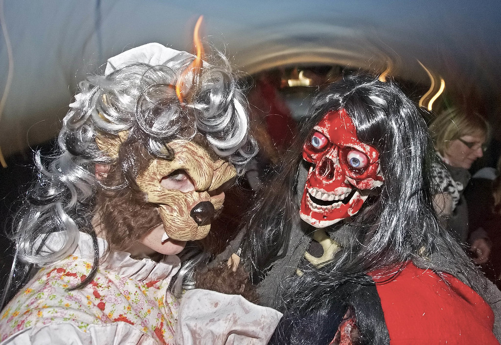 . Visitors dressed with masks play during a Halloween celebration in the leisure park \'BELANTIS\', the largest theme park in eastern Germany, in Leipzig, central Germany, Thursday, Oct. 31, 2013. The event park staged a Halloween party with creepy surprises for the visitors. (AP Photo/Jens Meyer)