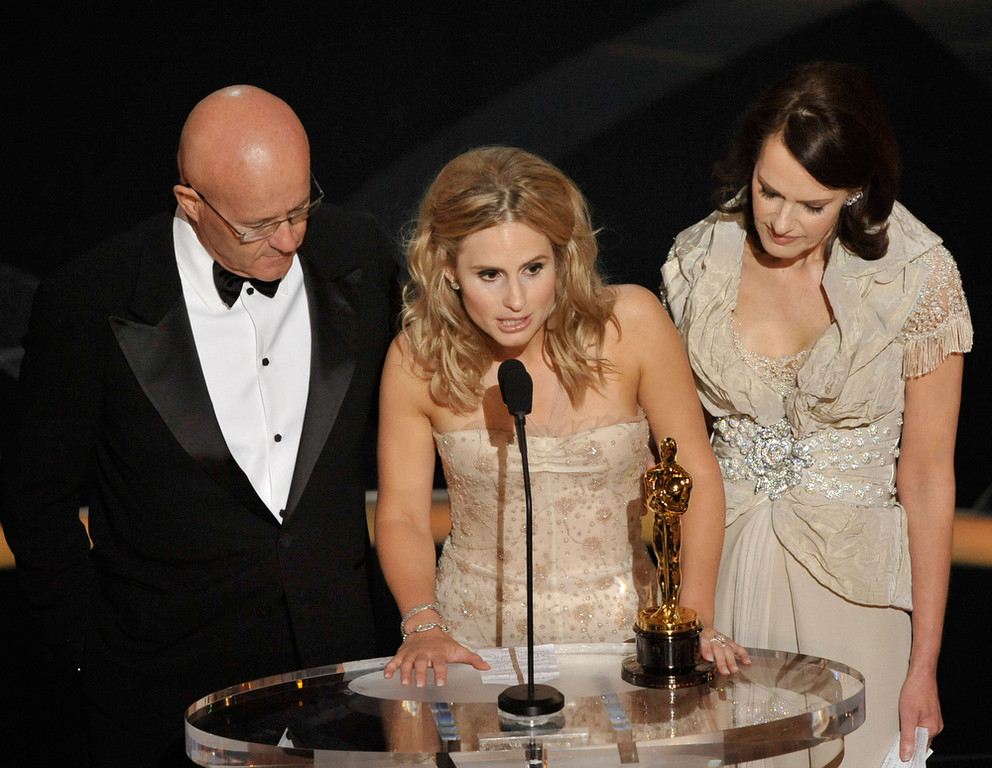". Kate Ledger (C), sister of late Heath Ledger, accepts the award for Best Supporting Actor for ""The Dark Night\"" with father Kim (L) and mother Sally (R) during the 81st Annual Academy Awards held at Kodak Theatre on February 22, 2009 in Los Angeles, California.  (Photo by Kevin Winter/Getty Images)"