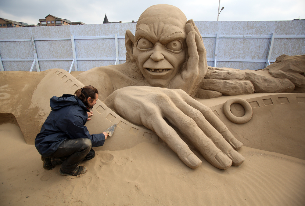 . Sand sculptor Radavan Zivny works on a sand sculpture of Gollum as pieces are prepared as part of this year�s Hollywood themed annual Weston-super-Mare Sand Sculpture festival on March 26, 2013 in Weston-Super-Mare, England. Due to open on Good Friday, currently twenty award winning sand sculptors from across the globe are working to create sand sculptures including Harry Potter, Marilyn Monroe and characters from the Star Wars films as part of the town\'s very own movie themed festival on the beach.  (Photo by Matt Cardy/Getty Images)