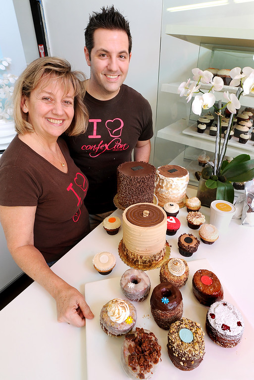 """. Co-owners Vandy Altounian and Anthony Valerio at ConfeXi Cupcakes+Cake in Old Pasadena. It�s all the rage in N.Y., and it�s making its way into the LA region - the Cronut! And, of course, a small bakery in Pasadena has jumped on the bandwagon, as one of the few brave souls in the area to offer the highly sought-after treat in Old Pasadena. \""""Brioughnut\"""" a new product is a sophisticated hybrid of the all-American doughnut,rich,  with flaky layers of brioche dough, handcrafted and laminated using the finest European butter Wednesday August 21, 2013.(SGVN/Photo by Walt Mancini)"""