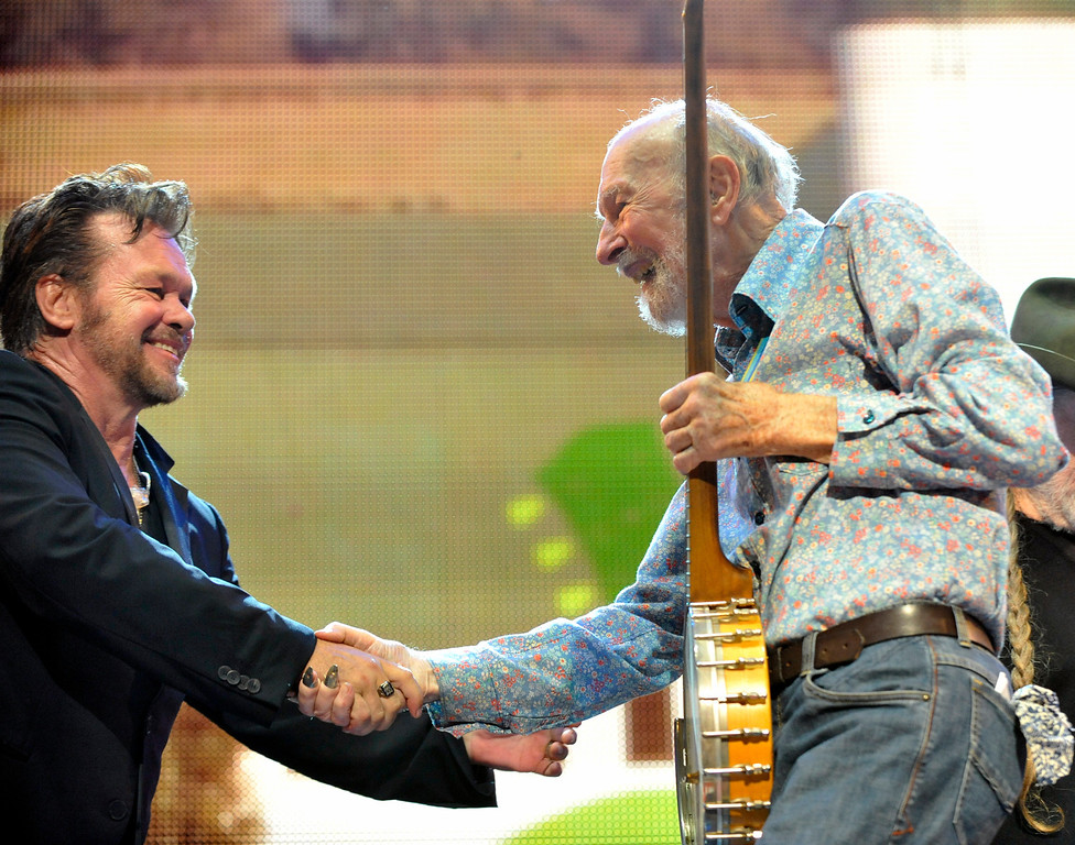 . File-This Sept. 21, 2013 file photo shows John Mellencamp, left, and Pete Seeger on stage during the Farm Aid 2013 concert at Saratoga Performing Arts Center in Saratoga Springs, N.Y.  The American troubadour, folk singer and activist Seeger  died Monday Jan. 27, 2014, at age 94.  (AP Photo/Hans Pennink, File)