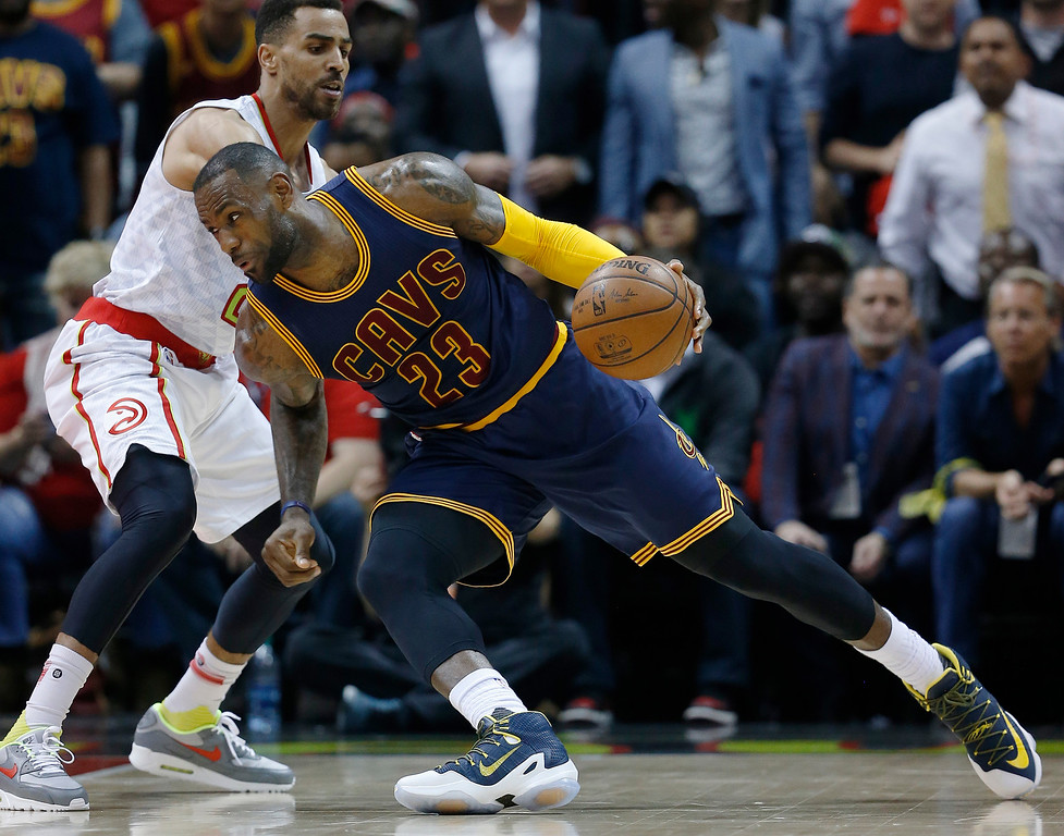 . Cleveland Cavaliers forward LeBron James (23) works against the Atlanta Hawks in the first half of Game 3 of the second-round NBA basketball playoff series, Friday, May 6, 2016, in Atlanta. (AP Photo/John Bazemore)