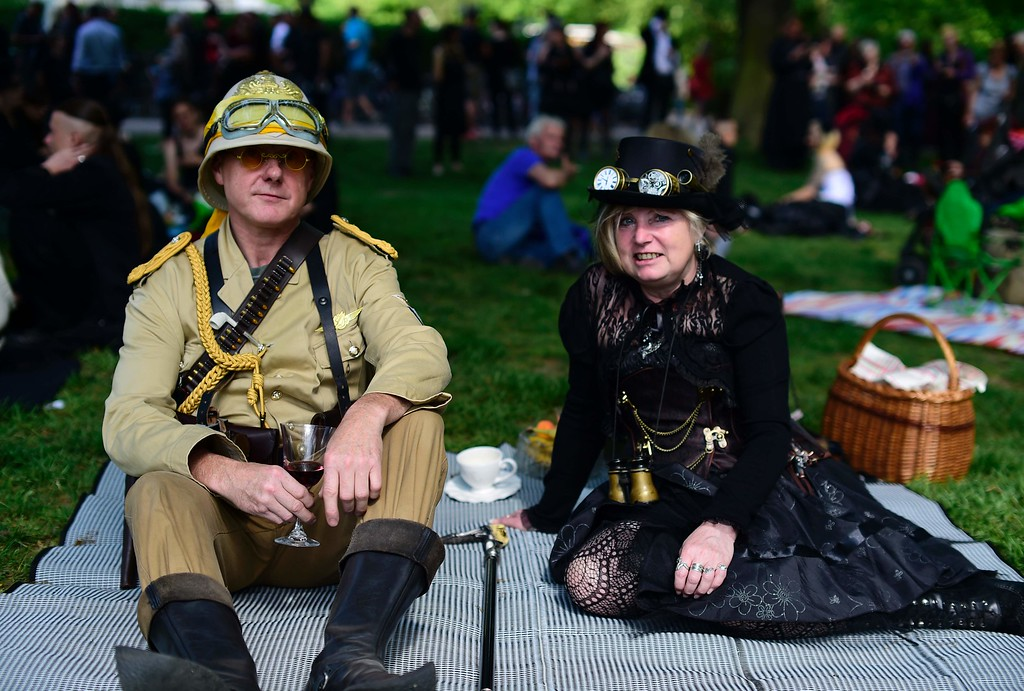 """. Dressed up people attend a so-called \""""Victorian Picnic\"""" during the Wave-Gotik-Treffen (WGT) festival in Leipzig, eastern Germany, on May 13, 2016.   / AFP PHOTO / TOBIAS SCHWARZ/AFP/Getty Images"""
