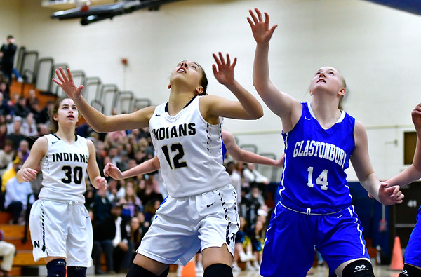 3/1/2019 Mike Orazzi | Staff Newington High School''s Alexie Armour (12) and Glastonbury Tomahawks' Hannah Van Dyke (14) during the Class LL Second Round of the CIAC 2019 State Girls Basketball Tournament at Newington High School Friday night.
