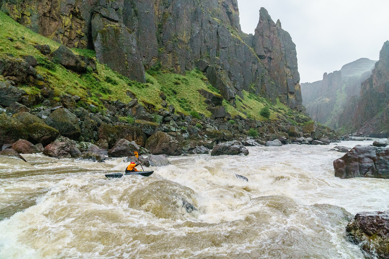 "Christian Woodard runs ""Widowmaker,"" the biggest rapid on the Middle Owyhee, as a snow storm settles in."