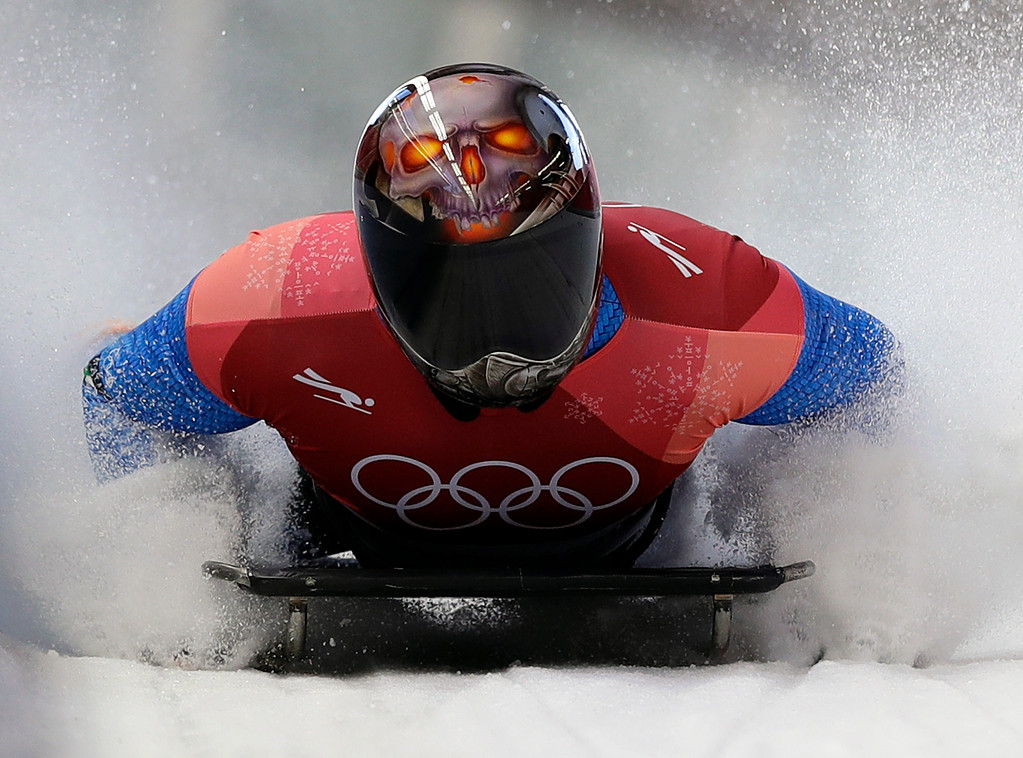 . Joseph Luke Cecchini of Italy brakes in the finish area after his second run during the men\'s skeleton competition at the 2018 Winter Olympics in Pyeongchang, South Korea, Thursday, Feb. 15, 2018. (AP Photo/Wong Maye-E)