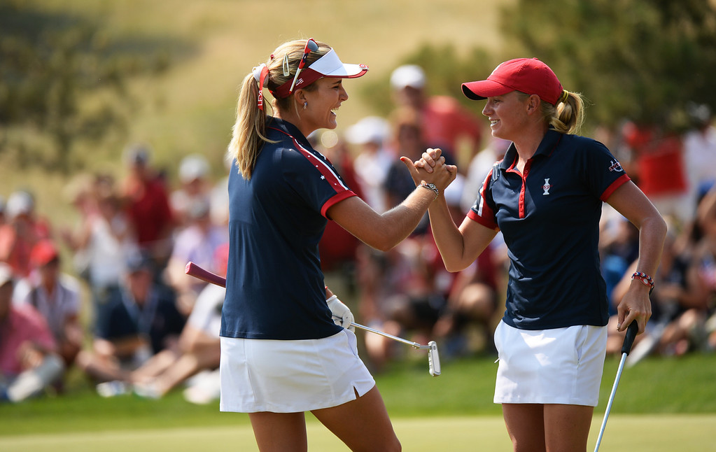 . PARKER, CO. - August 16: Lexi Thompson, left, and Stacy Lewis of team USA celebrate Thompson\'s birdie putt on 9th green during 2013 Solheim Cup at Colorado Golf Club. Parker, Colorado. August 16, 2013. (Photo By Hyoung Chang/The Denver Post)