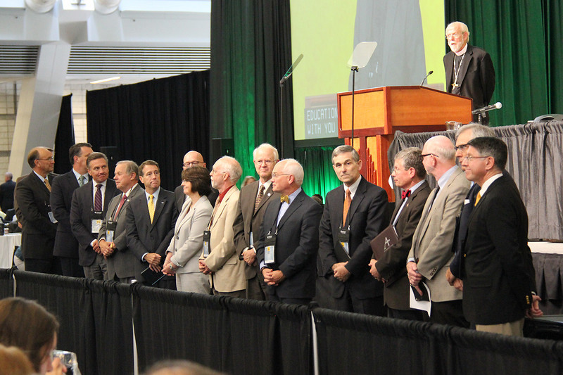 The presidents of the ELCA colleges and universities who are at the Assembly are asked to come forward.