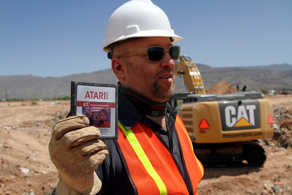 . Film Director Zak Penn shows a box of a decades-old Atari \'E.T. the Extra-Terrestrial\' game found in a dumpsite in Alamogordo, N.M., Saturday, April 26, 2014. Producers of a documentary dug in a southeastern New Mexico landfill in search of millions of cartridges of the game that has been called the worst game in the history of video gaming and were buried there in 1983. (AP Photo/Juan Carlos Llorca)