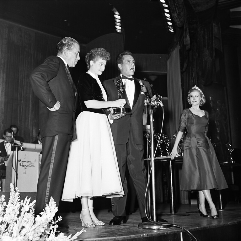 . HOLLYWOOD, CA - FEBRUARY 11, 1954: (L-R) Teleivsion host Ed Sullivan, and actors Desi Arnaz and Lucille Ball accept the award for Best Comedy Show, �I Love Lucy,� during the 1953 Emmy Awards at the Hollywood Palladium on February 11, 1954 in Hollywood, California. (Photo by TVA/PictureGroup/Invision for the Academy of Television Arts & Sciences/AP Images)