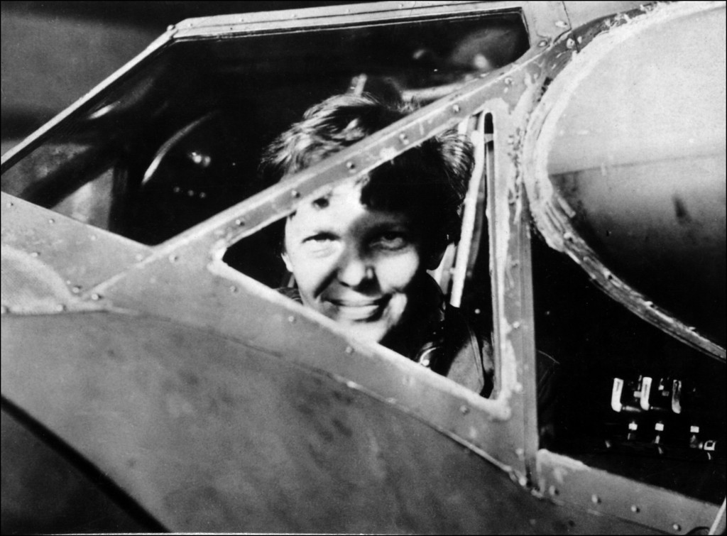 . FRANCE - JANUARY 1:  Undated picture taken in the 30\' s of American female aviator Amelia Earhart looking trough the cockpit window of her plane. Amelia Earhart was the first woman to fly the Atlantic as a passenger, in 1928, and followed this by a solo flight in 1932. In 1935 she flew solo from Hawan to Califofrnia. In 1937, with Fred Noonan, they set out to fly round the world, but their plane was lost over the Pacific, 02 July.  (STAFF/AFP/Getty Images)