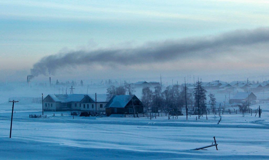 . Smoke rises above houses in the village of Maralayi, in the Republic of Sakha, northeast Russia, January 19, 2013. The coldest temperatures in the northern hemisphere have been recorded in Sakha, the location of the Oymyakon valley, where according to the United Kingdom Met Office a temperature of -67.8 degrees Celsius (-90 degrees Fahrenheit) was registered in 1933 - the coldest on record in the northern hemisphere since the beginning of the 20th century. Yet despite the harsh climate, people live in the valley, and the area is equipped with schools, a post office, a bank, and even an airport runway (albeit open only in the summer).    Picture taken January 19, 2013.    REUTERS/Maxim Shemetov