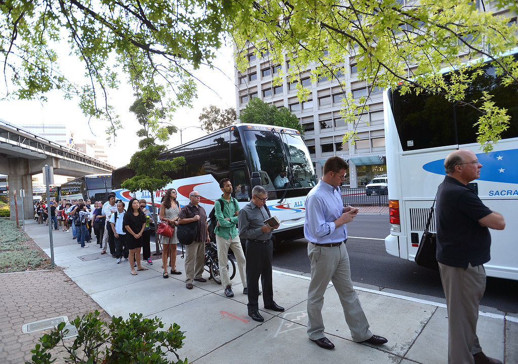 . A long line of commuters work their way down California Boulevard to a line of buses awaiting to take them to San Francisco on the second day of the BART strike in Walnut Creek, Calif., on Tuesday, July 2, 2013.  (Dan Rosenstrauch/Bay Area News Group)