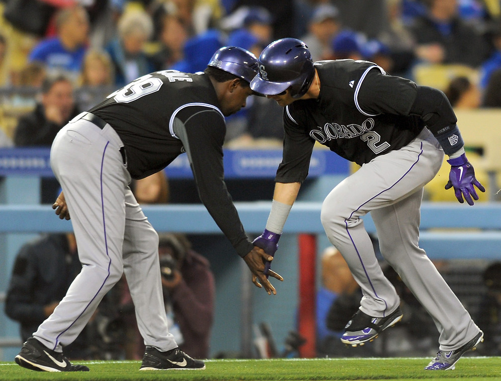. The Rockies\' Troy Tulowitzki low-fives third base coach Stu Cole after hitting a solo homer in the second inning against the Dodgers, Friday, April 25, 2014, at Dodger Stadium. (Photo by Michael Owen Baker/L.A. Daily News)