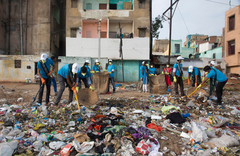 ". Members of National Green Corps clean up plastic garbage along the Musi river in Hyderabad, India, Sunday, June 3, 2018. India is the global host for the forthcoming environmental day celebrations on june 5, 2018 with a theme ""Beat Plastic Pollution\"" and launched an awareness program on environmental protection. (AP Photo/Mahesh Kumar A.)"