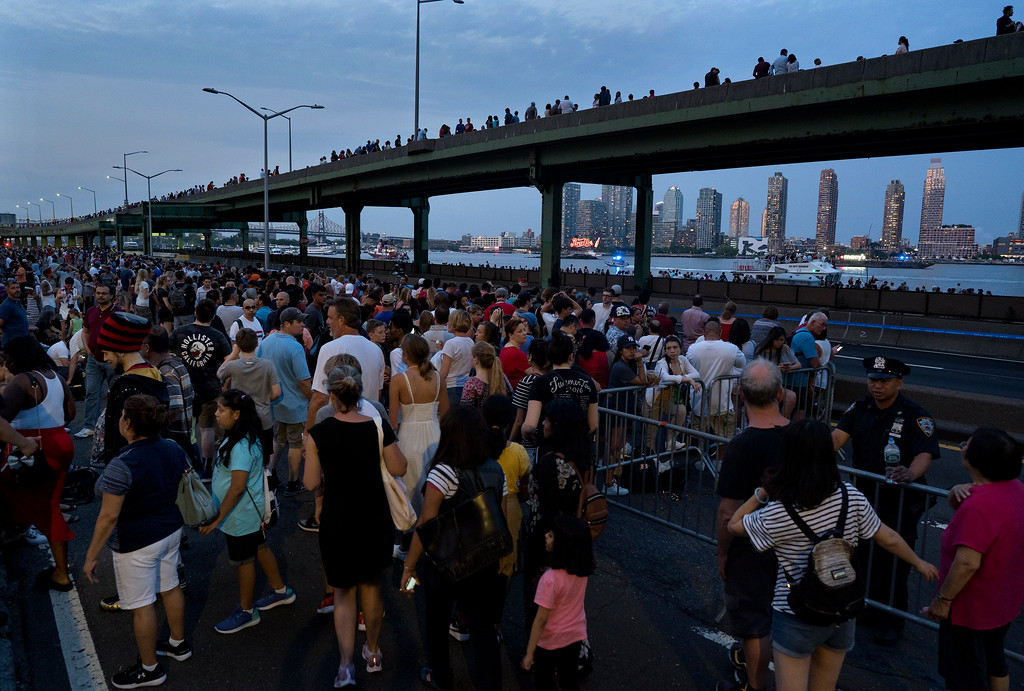 . Spectators wait on the east side of Manhattan borough before a fireworks display, part of Independence Day festivities Wednesday, July 4, 2018, in New York. (AP Photo/Craig Ruttle)