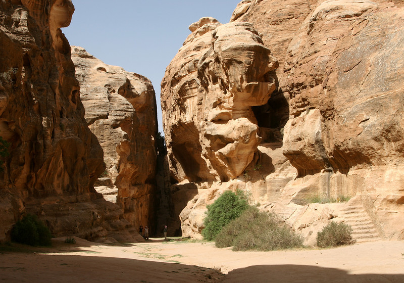 Little Petra (Siq Al-Barid) - At the end of the siq are are some steps which climb up through a narrow gap in the rock (centre) to another valley from where it is possible to walk to The Monastery at Petra.  The steps on the right go up to another(dining?) room carved into the rock.