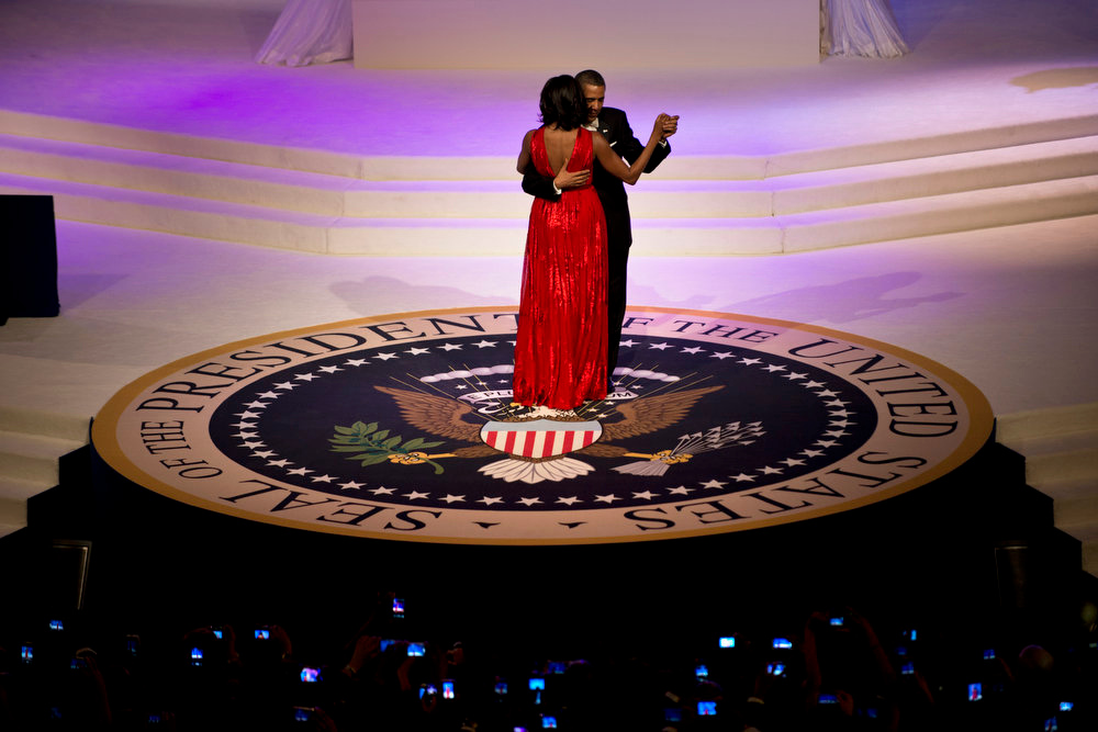 Description of . US President Barack Obama and First Lady Michelle Obama dance while attending the Commander and Chief Ball at the Washington Convention Center January 21, 2013 in Washington, DC. Obama and Biden attended Inauguration balls after being ceremonially sworn in for a second term leading the United States earlier today.  BRENDAN SMIALOWSKI/AFP/Getty Images