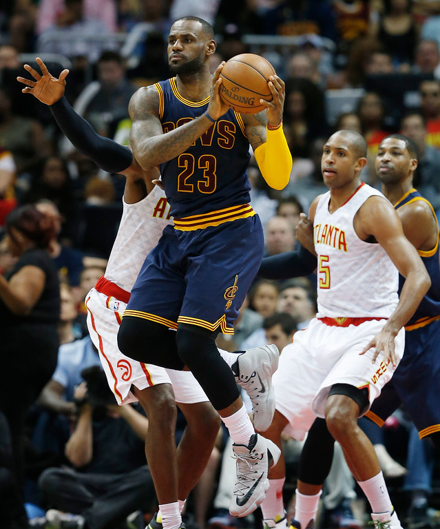 . Cleveland Cavaliers forward LeBron James (23) looks to pass the ball against the Atlanta Hawks in the first half of Game 4 of the second-round NBA basketball playoff series, Sunday, May 8, 2016, in Atlanta. (AP Photo/John Bazemore)