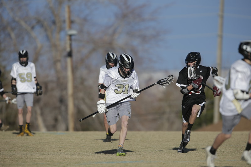 JPM0059-JPM0059-Jonathan first HS lacrosse game March 9th.jpg
