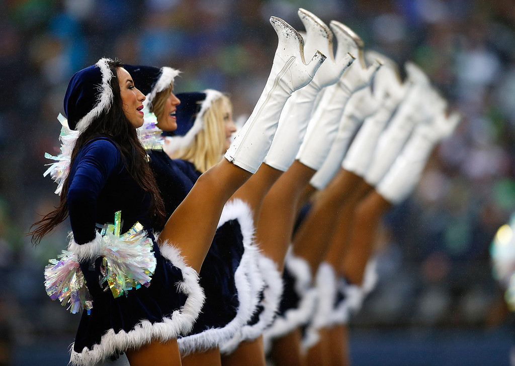 . Cheerleaders perform during  the Seattle Seahawks versus the Arizona Cardinals game on December 22, 2013 at CenturyLink Field in Seattle, Washington.  (Photo by Jonathan Ferrey/Getty Images)