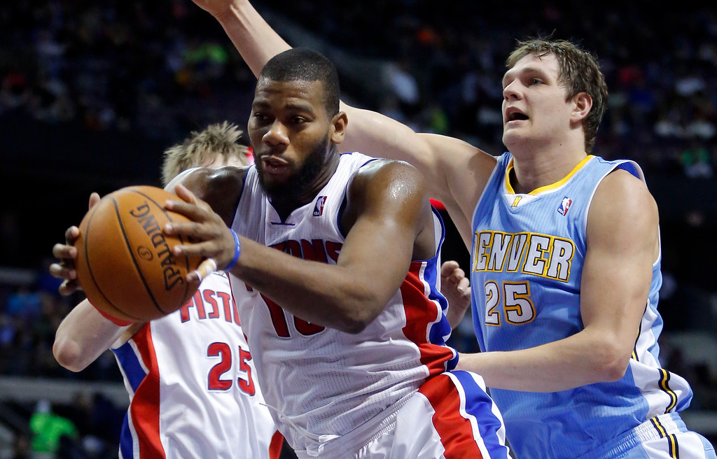 . Detroit Pistons center Greg Monroe, front left, grabs a rebound in front of Denver Nuggets center Timofey Mozgov (25) during the first half of an NBA basketball game on Saturday, Feb. 8, 2014, in Auburn Hills, Mich. (AP Photo/Duane Burleson)