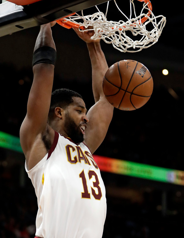 . Cleveland Cavaliers\' Tristan Thompson dunks against the Indiana Pacers during the first half of an NBA basketball game Friday, Jan. 26, 2018, in Cleveland. (AP Photo/Tony Dejak)