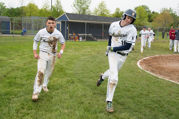 05/14/19 Wesley Bunnell | Staff Newington baseball defeated New Britain 4-3 in a walk off on Tuesday afternoon at Newington High School. Newington's Gunnar Johnson (5) and Jack Kelley (18) after shaking hands with New Britain.