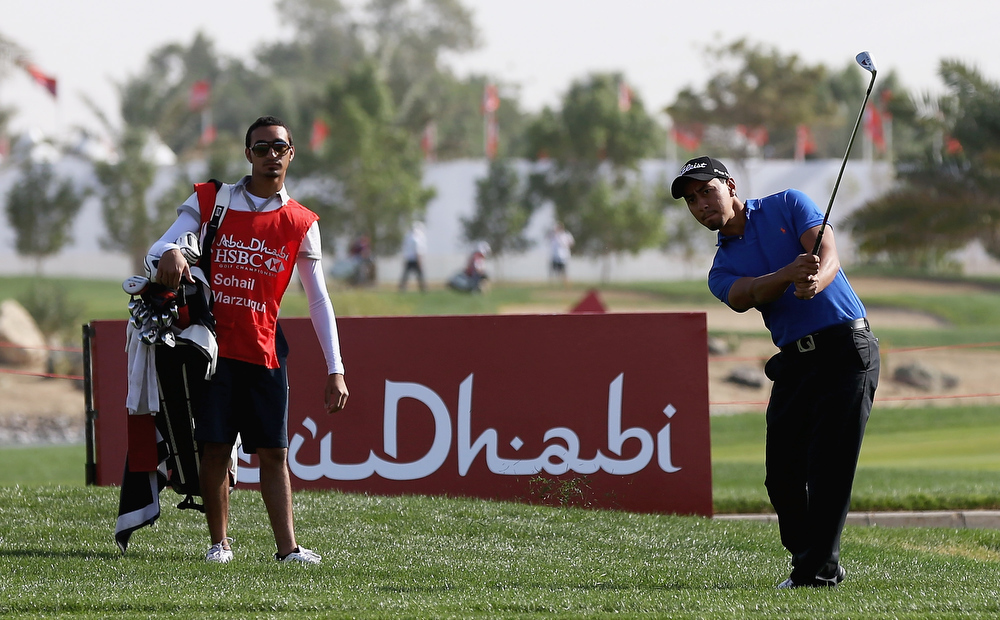 Description of . Sohail Al Marzuqui of the UAE chips onto the 18th green during day one of the Abu Dhabi HSBC Golf Championship at Abu Dhabi Golf Club on January 17, 2013 in Abu Dhabi, United Arab Emirates.  (Photo by Matthew Lewis/Getty Images)