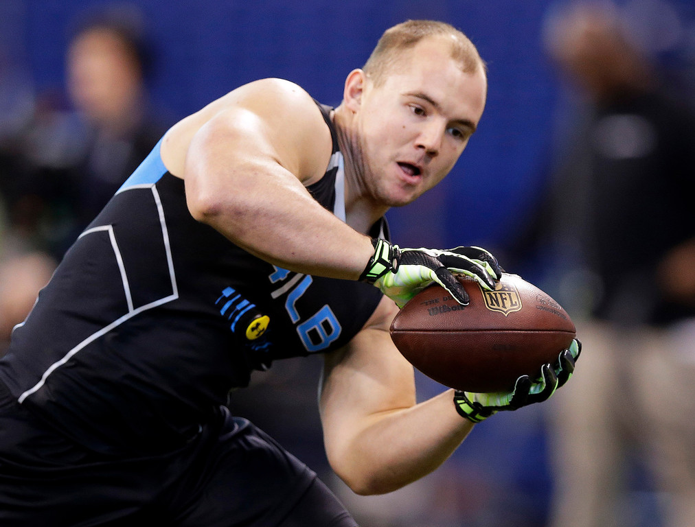 . Wisconsin linebacker Chris Borland makes a catch as he runs a drill at the NFL football scouting combine in Indianapolis, Monday, Feb. 24, 2014. (AP Photo/Michael Conroy)