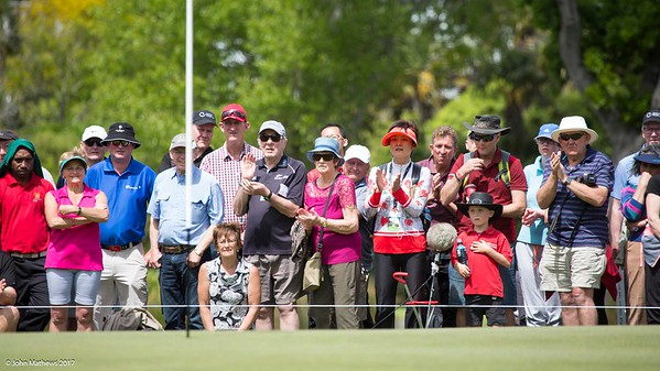 Eventual winner Yuxin Lin's mother (in the red sun visor) applauds his second shot to the par five 18th green on the final day of the Asia-Pacific Amateur Championship tournament 2017 held at Royal Wellington Golf Club, in Heretaunga, Upper Hutt, New Zealand from 26 - 29 October 2017. Copyright John Mathews 2017.   www.megasportmedia.co.nz